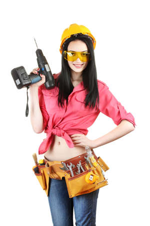hand drill: beautiful young girl-builder  holding drill isolated on white