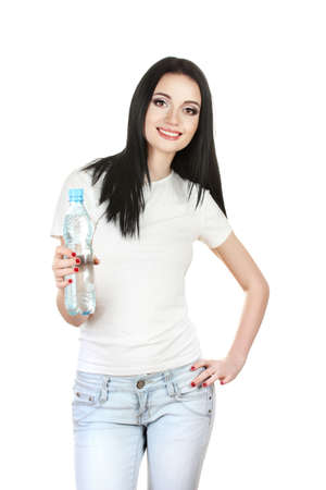 beautiful young girl and bottle of water isolated on white photo