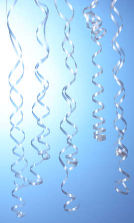 beautiful streamers on blue background photo