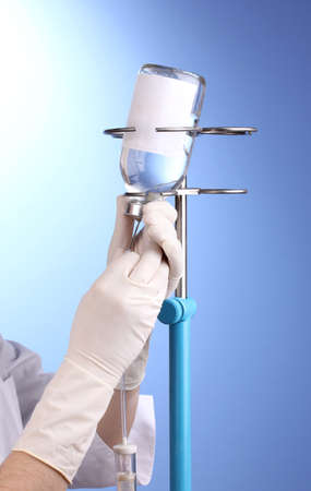 Nurse doing infusion on blue background photo