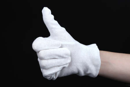 hand held: cloth glove on hand on black background