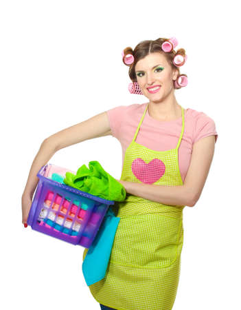 stereotypical: beautiful young housewife with basket of folded laundry isolated on white