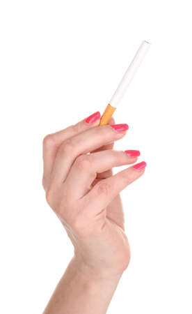 Cigarette in female hand isolateed on white photo