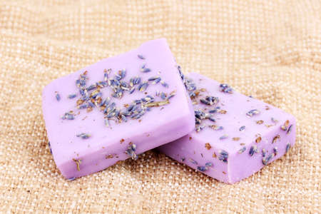 Hand-made lavender soaps on sackcloth Stock Photo - 12799543