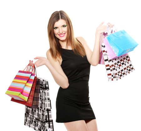Shopaholic: beautiful young woman with shopping bags isolated on white Stock Photo
