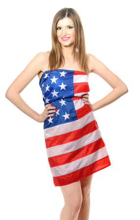 beautiful young woman wrapped in American flag isolated on white photo