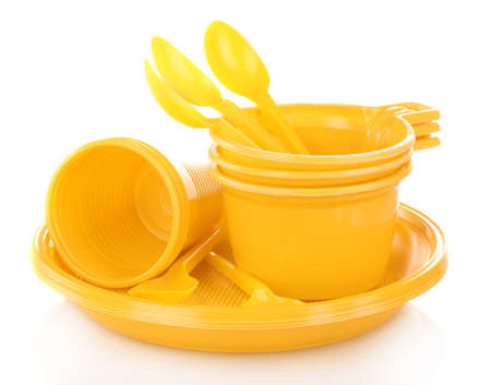 Bright yellow plastic tableware isolated on white Stock Photo - 12821765