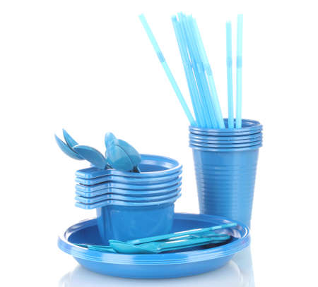 Bright blue plastic tableware isolated on white photo