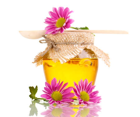 Sweet honey in jar with drizzler isolated on white photo