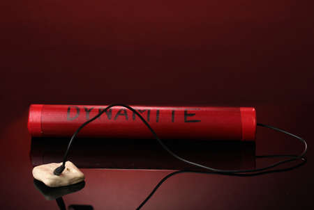 Dynamite on red background photo