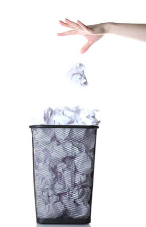dispose: hand going garbage in metal trash bin from paper isolated on white