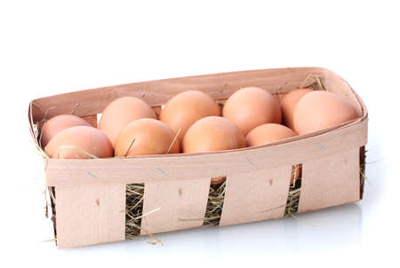 brown eggs in box isolated on white photo