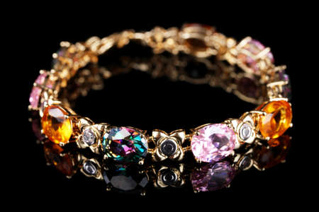 Beautiful bracelet with precious stones on black background Stock Photo - 12892076