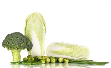Fresh cabbages, broccoli and green onions isolated on white photo
