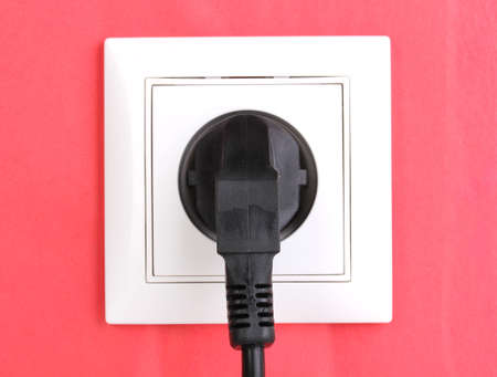 White electric socket with plug on the wall Stock Photo - 12913027