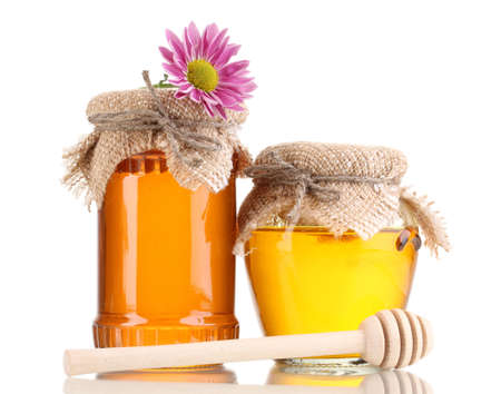 Sweet honey in jars with drizzler isolated on white photo