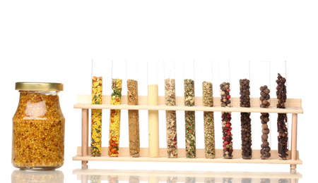 Various spices in tubes and bottle of mustard isolated on white photo