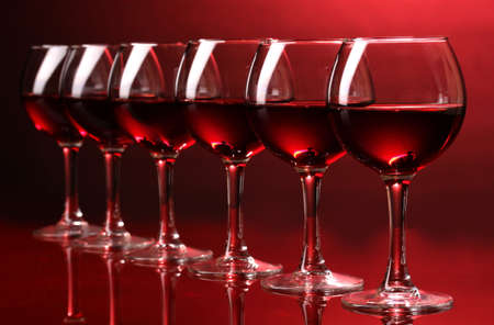 degustation: Wineglasses on red background Stock Photo