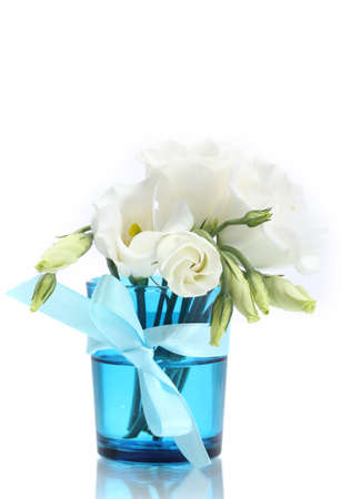 beautiful spring flowers in blue vase isolated on white photo