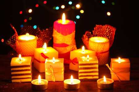 Wonderful candles on wooden table on bright background Stock Photo - 12891952