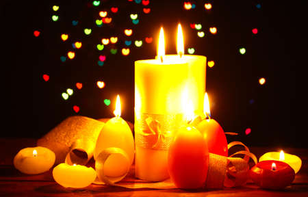 Beautiful candle and decor on wooden table on bright background Stock Photo - 12891953