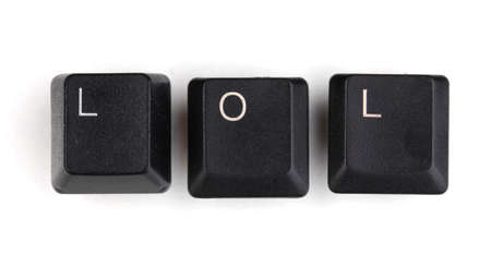 Keyboard keys saying lol isolated on white photo