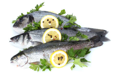 Fresh fishes with lemon, parsley and spice isolated on white Stock Photo - 12891963