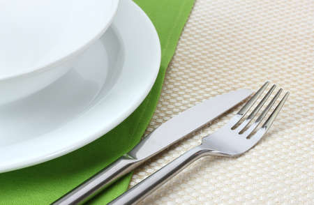 Table setting with fork, knife, plates, and napkin Stock Photo - 12891972