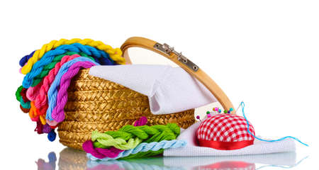 made to measure: bright threads for needlework and fabric in a wicker basket