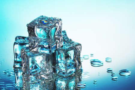 Melting ice cubes on blue background Stock Photo - 12979853