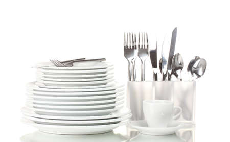 Clean plates and cutlery isolated on white photo