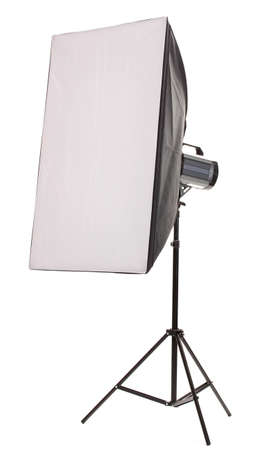 Studio flash with soft-box on white background photo