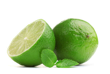 Fresh lime with mint isolated on white photo