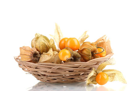 Physalis in basket isolated on white photo