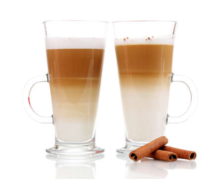 Fragrant сoffee latte in glass cups and cinnamon isolated on white photo