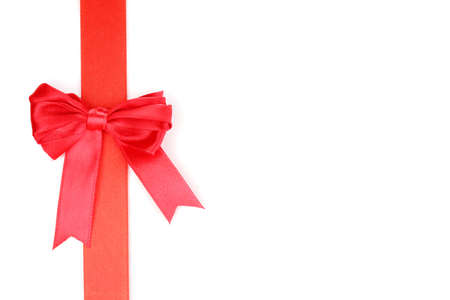 Red satin bow and ribbon isolated on white photo
