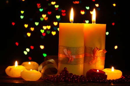 Beautiful candle and decor on wooden table on bright background Stock Photo - 12980075