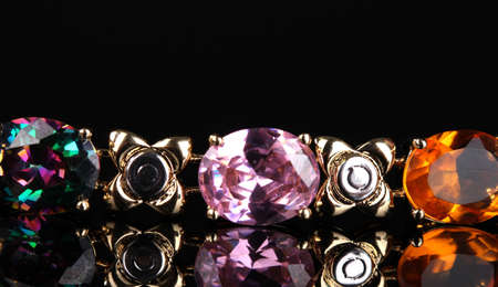 Beautiful bracelet with precious stones on black background Stock Photo - 12980047