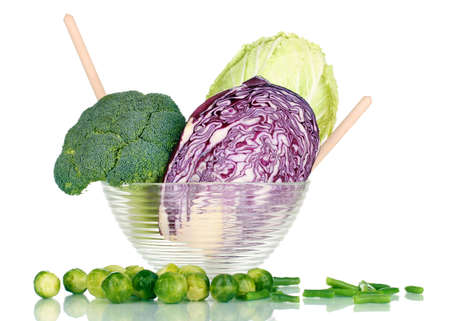 Glass bowl with cabbages and broccoli isolated on white Stock Photo - 12980072