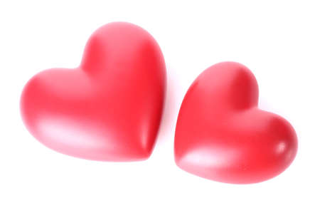two decorative red hearts isolated on white  photo