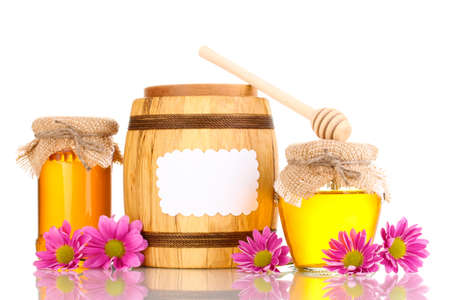 Sweet honey in jars and barrel with drizzler isolated on white Stock Photo - 12980048