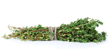fresh green thyme isolated on white photo