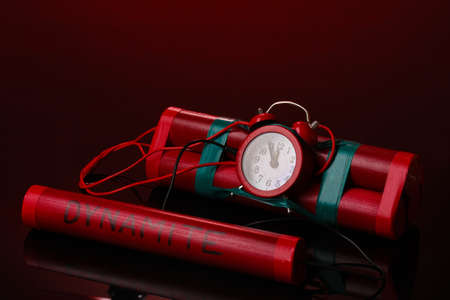 Timebomb made of dynamite on red background Stock Photo - 12980064