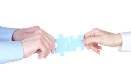 Hands with puzzle isolated on white photo