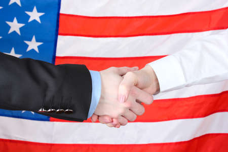 Business handshake on american flag background Stock Photo - 12979930