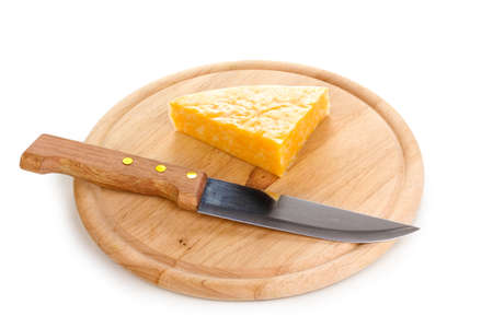 Cheese on cutting board with knife isolated on white photo