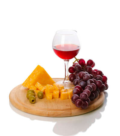 Wine in wineglass and cheese isolated on white photo