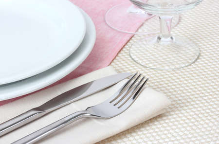 Table setting with fork, knife, plates, and napkin Stock Photo - 12979526