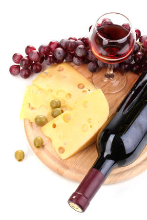 Bottle of great wine with wineglass and cheese isolated on white photo
