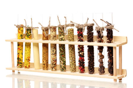 Various spices in tubes isolated on white photo
